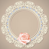 White empty lace frame doily with realistic rose on beige background Royalty Free Stock Images