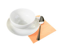 White empty mug and spoon on orange paper napkin Royalty Free Stock Photos