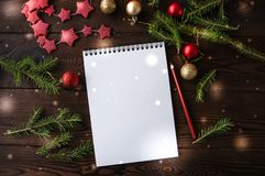 White empty notepad paper with christmas decoration on a wooden. Background. Flat lay stock photo