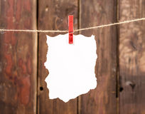 White empty paper note hanging on clothesline Stock Images