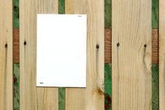 White Empty Paper Sheet On The Wooden Fence Royalty Free Stock Photo