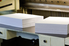 White Empty Papers on a Paper Cutter Machine Stock Images