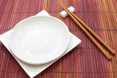 White empty plate with chopsticks Royalty Free Stock Images