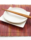 White empty plate with chopsticks Stock Images