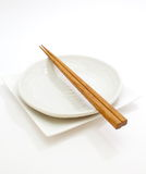 White empty plate with chopsticks Stock Photo