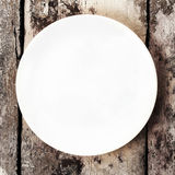 White empty plate with copy space for text on old wooden vintage Royalty Free Stock Image