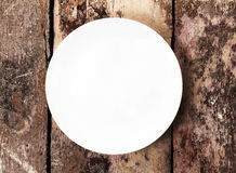 White empty plate with copy space for text on old wooden vintage Stock Image