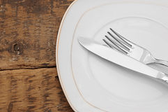 White empty plate with fork and knife Stock Photography