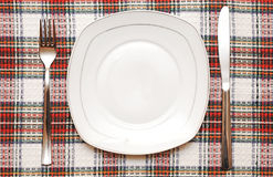White empty plate with fork and knife Royalty Free Stock Photos