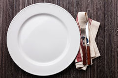 White empty plate with fork and knife Royalty Free Stock Images