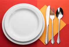 White empty plate with fork, spoon and knife Stock Photo