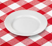 White Empty Plate On Red Gingham Tablecloth Stock Photo