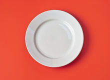 White empty plate on red background top view Stock Photo