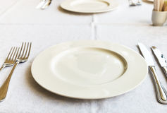 White empty plate on table Royalty Free Stock Image