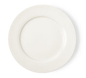 White empty plate on white background. White empty plate on a white background royalty free stock photography