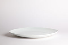 White empty plate on white background. Front view Stock Image