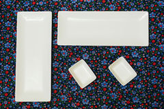 White empty plates on the dark colorful tablecloth. View from above.Example table setting Royalty Free Stock Photos