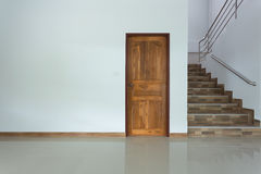 White empty room interior with wooden door Stock Photography