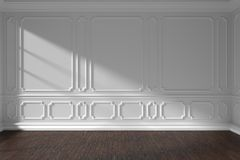 White empty room wall with molding and dark parquet floor. White empty room wall interior with sunlight from window, decorative classic style molding frames on Royalty Free Stock Image
