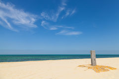 White empty sandy beach with shower. And beautiful cloudy sky Stock Photos