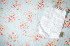 white empty sheet on tablecloth stock photography