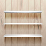 White empty shelves on the wall. White empty shelves on the natural wood wall. For book or product presentation Stock Photos