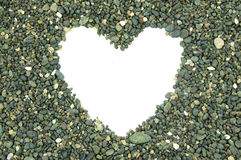 White empty space heart-shaped. In the middle piles of stone Royalty Free Stock Photos