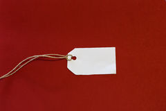 White empty tag on a red background Royalty Free Stock Photography