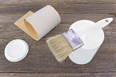 White enamel paint with brush and sandpaper Royalty Free Stock Photo