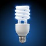 White energy saving light bulb on blue. 3d render of a glowing blue energy saving light bulb Stock Images