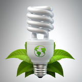 White energy saving light bulb with leafs on white. 3d render of a white energy saving light bulb, surrounded by leafs isolated on white stock illustration
