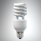 White energy saving light bulb on white. 3d render of a white energy saving light bulb, surrounded by leafs isolated on white royalty free illustration