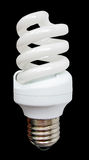 White energy saving light glass bulb, low power. Alternative low power glass frosted white lightbulb with metal cap isolated on black background. Kyoto protocol Stock Photo
