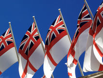White Ensign flags flying from Admiralty Arch. White Ensign, Royal Navy maritime flags flying from Admiralty Arch in London royalty free stock photography