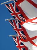 White Ensign Union Jack. Royal Navy maritime flags flying from Admiralty Arch in London royalty free stock photography