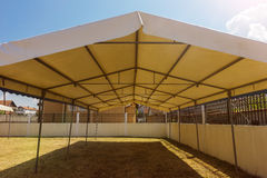 White entertainment tent in the garden in the sunlight Royalty Free Stock Photos