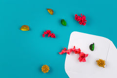 White envelop and colorful dried flowers, plants on blue background. Top view, flat lay Stock Photography