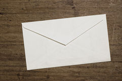 White envelope. On wooden table, studio shot Royalty Free Stock Images