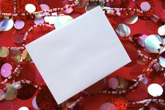 White Envelope against a festive Red Background Royalty Free Stock Photos