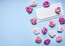 White envelope blue background with colorful paper roses border ,place for text  decorations for Valentine's Day top view clo Stock Photography
