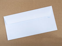 White envelope on cardboard Royalty Free Stock Photography