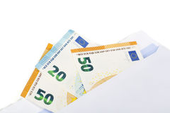 White envelope with full of euro banknotes on white background. Concept of corruption and bribery Stock Photos