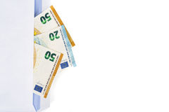 White envelope with full of euro banknotes on white background. Concept of corruption and bribery Stock Photography