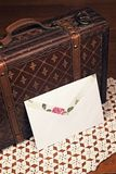 White envelope and leather case Stock Images