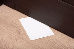 White envelope with message slipped under wooden Royalty Free Stock Image