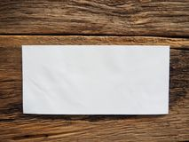 White envelope on old table royalty free stock image