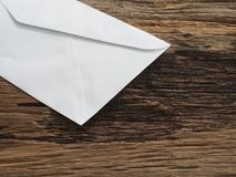 White envelope on old table stock photography