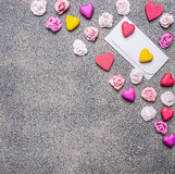 White envelope with paper hearts and roses on a granite background decorations for Valentine's Day top view close up Stock Image