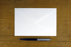 White envelope with pen Royalty Free Stock Photos