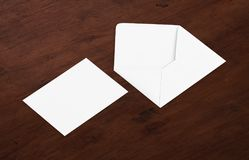 White blank envelope mockup and blank letterhead presentation template. White envelope and post card on a background, top view. Blank envelope mockup and blank Stock Photography